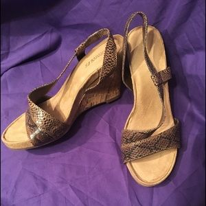 Comfortable in styleSnakeskin look w/ cork sandals